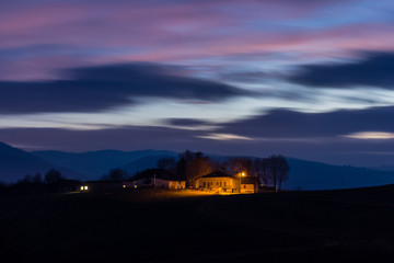 Farmhouse, Altopiano of Asiago, Province of Vicenza, Veneto, Italy. Farmhouses in the evening light.