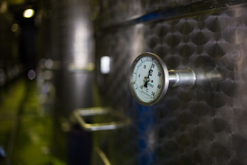 Close up image of steel wine tanks in a winery in South Africa