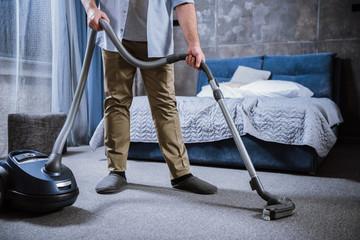 Man with vacuum cleaner