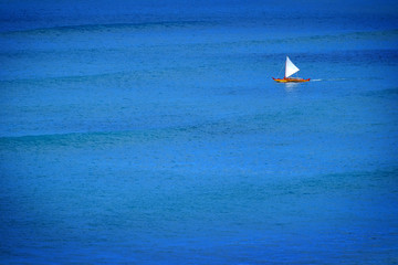 Sailboat Sailing on Calm Blue Ocean