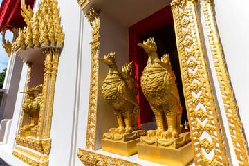 Golden chicken statue on window