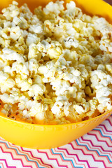Cheesy popcorn in a yellow bowl