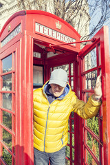 mature man walks into a red telephone box in London