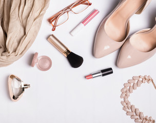 Woman's accessories on white table, top view