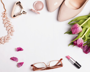 Stylish feminine acessories and pink tulips