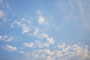 blue sky and clouds. tiny fuffy cloud under blue sky.