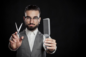 stylish hairdressers in the studio with scissors and comb