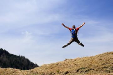 Spoed Fotobehang Luchtsport Person macht Freudensprung