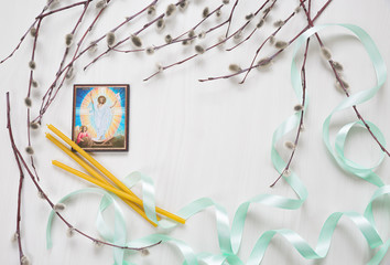 Light background with ikon of Jesus image, Church candles and willow branches. Space for text. Happy Easter postcard