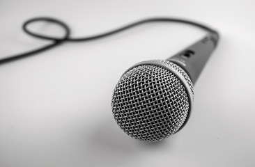 Microphone with a wire isolated on white background.