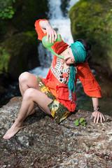 jala neti nasal irrigation with a girl near a waterfall