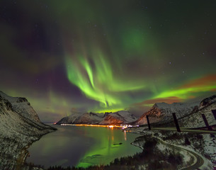 Aurora borealis (Polar lights) over the mountains in the North of Europe - Senja island, Troms county, Norway.