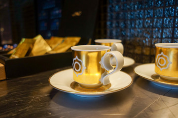 Dubai. Summer 2016. Artistic coffee Cup with a gold pattern in the presidential Suite at the Four Seasons Jumeirah.