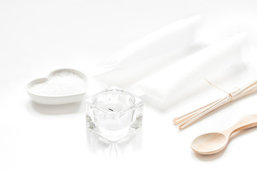 white set of cosmetics for spa on table background