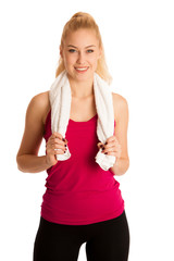 Woman resting after fitness workout with towel arounfd her neck isolated over white