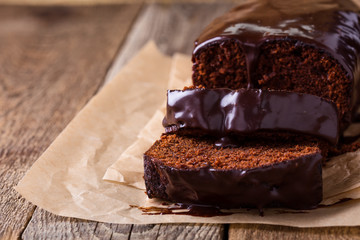 Homemade chocolate cake on wooden table