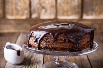 Homemade chocolate cake on glass cakestand