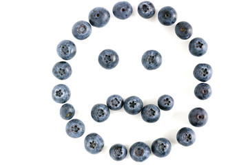 closeup of isolated blueberry angry face on white background