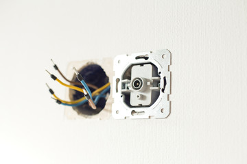 TV socket on the wall. Installation of electricians in the apartment