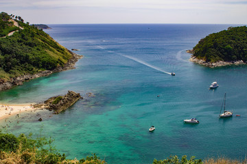 Boat rental in phuket thailand, rental agency in Bangkok Thailand.  Diving in tropical reefs.  Explore by land and sea and dive to see coral and fish.  Copyspace.