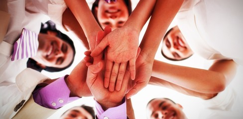 Portrait of business team stacking hands