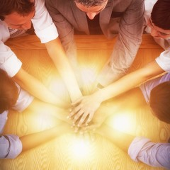 High angle view of business team stacking hands