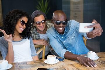 Cheerful friends wearing sunglasses