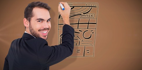 Composite image of happy businessman writing with marker