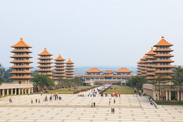 Kaohsiung, Taiwan. Fo Guang Shan buddist temple of Kaohsiung with many tourists walking by.