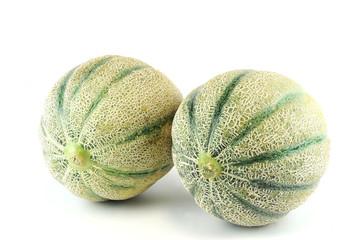 fresh cantaloupe melons on white background