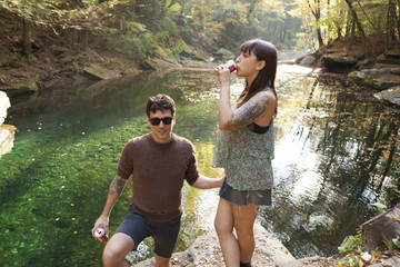 Young couple standing near a river