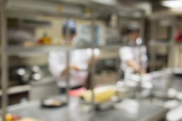 blurred chef Cooking  in restaurant kitchen