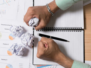 Close up of businessman work hard with crumpled paper in the office,Young man stressed with work.