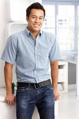 Happy man in shirt and jeans
