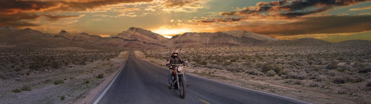 Biker On the road below beautiful sky