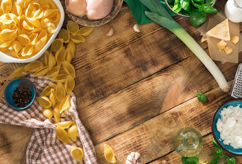 Top view frame of ingredients for cooking Italian pasta