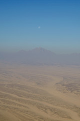 Aerial view of Egypt desert, mountains and blue sky
