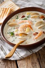 New England clam chowder soup close-up. vertical