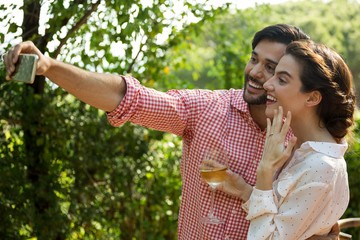 Couple taking selfie at park