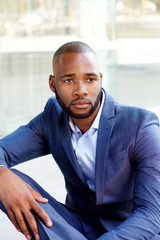 young african american business man sitting outdoors