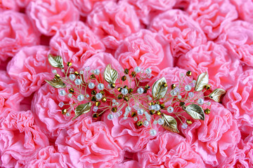 the ornament for the hair of beads and wire on a background of pink background