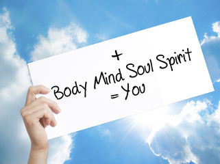 Body + Mind + Soul + Spirit = You Sign on white paper. Man Hand Holding Paper with text. Isolated on sky background