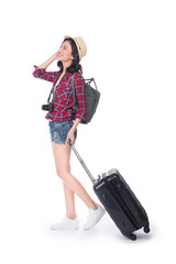 Woman travel. Young beautiful asian woman traveler with suitcase and camera on white background
