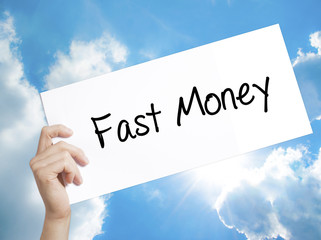Fast Money  Sign on white paper. Man Hand Holding Paper with text. Isolated on sky background