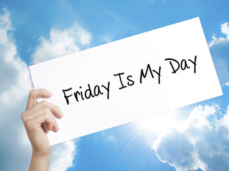 Friday Is My Day   Sign on white paper. Man Hand Holding Paper with text. Isolated on sky background