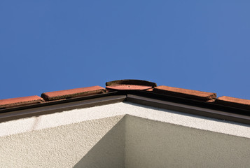 colorful tiles rooftop in sunlight and blue sky isolated