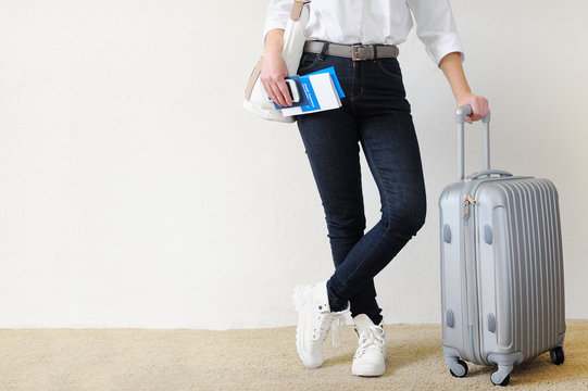Woman with the suitcase goes on a journey. Travel insurance.