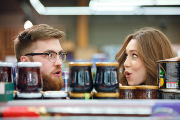 Couple looking at each other near jams in mall