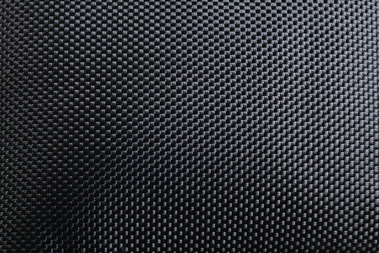 Black color of synthetic cloth texture close up photo show the detail of microfiber fabric texture surface background.