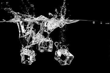 ice splash in water on black background